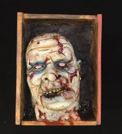 Zombie head in a box