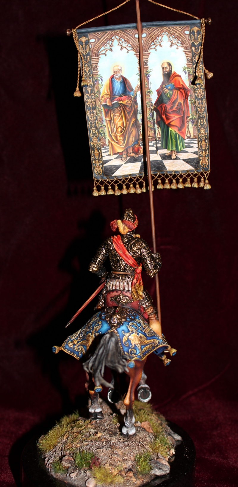Knight in parade armor with banner