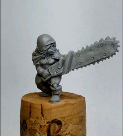 Dwarf girl with chainsaw