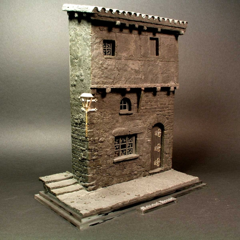 Medieval house corner with steps and street